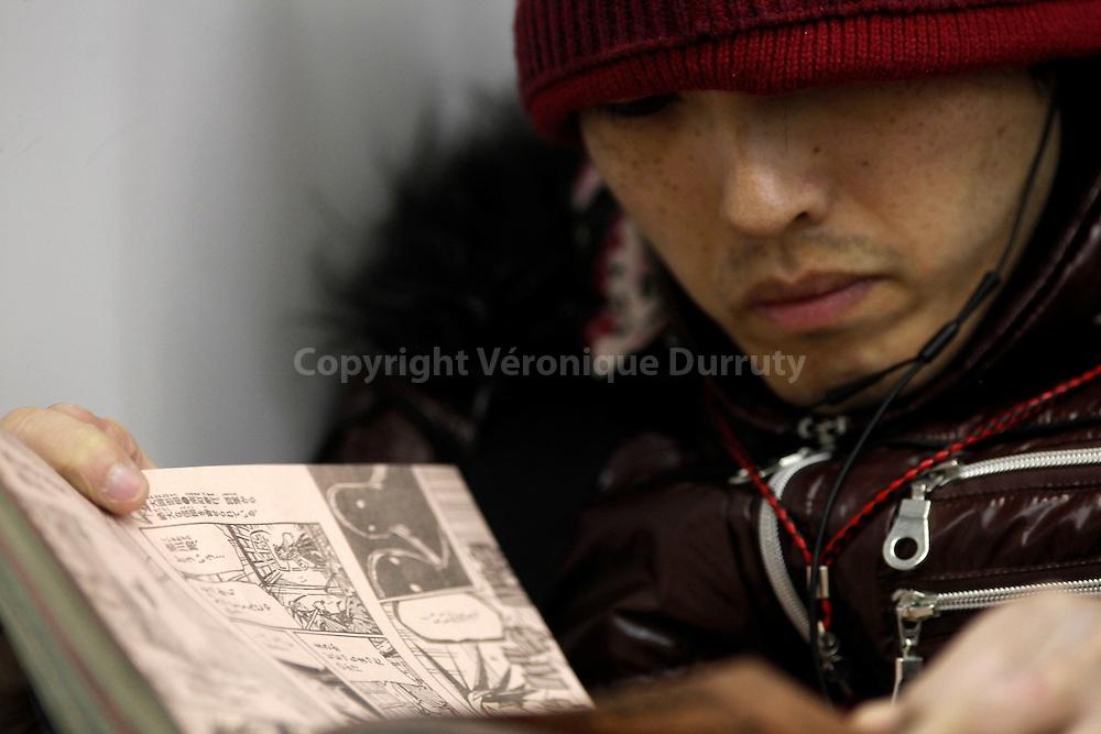 Boy Of Tokyo, Japan / Jeune homme deTokyo, Japon.Reading Mangas / Lire des mangas