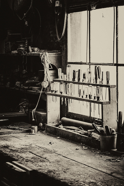 Boathouse window with tools in the St Michael Boat house, St michaels Maryland.