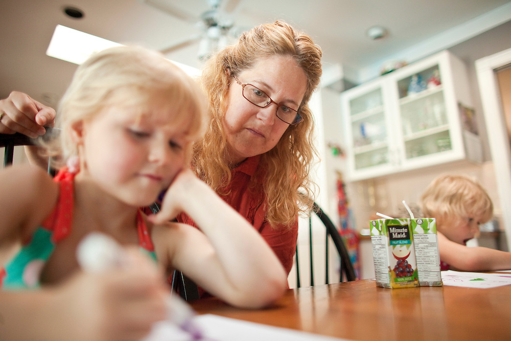 London, Ontario ---11-05-30--- Kim Thornton of  London, Ontario is trying to find inexpensive activities like colouring for her 4 children in order to save money to pay off more than $50,000 of consumer debt they have accumulated.<br /> GEOFF ROBINS The Globe and Mail