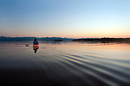 Kayaking on Lake Champlain at sunset at Button Bay in Vergennes, Vermont.