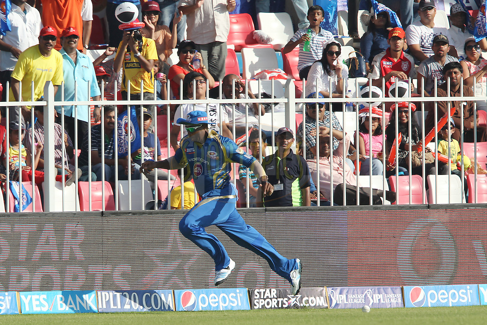 Kieron Pollard of the Mumbai Indians during match 16 of the Pepsi Indian Premier League 2014 between the Delhi Daredevils and the Mumbai Indians held at the Sharjah Cricket Stadium, Sharjah, United Arab Emirates on the 27th April 2014<br /> <br /> Photo by Ron Gaunt / IPL / SPORTZPICS