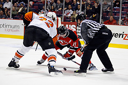 Mar 30, 2007; East Rutherford, NJ, USA; New Jersey Devils center John Madden (11) and Philadelphia Flyers right wing Mike Knuble (22) face off during the first period at Continental Airlines Arena in East Rutherford, NJ.