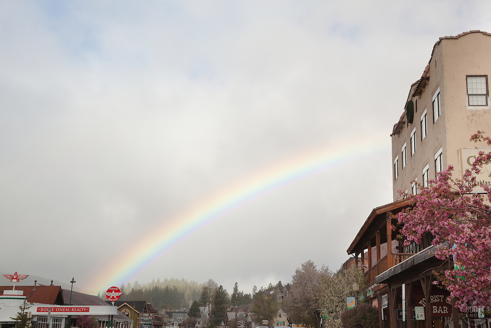 """Rainbow in Downtown Truckee"" - Photograph of a rainbow in the morning over historical Downtown Truckee, California."