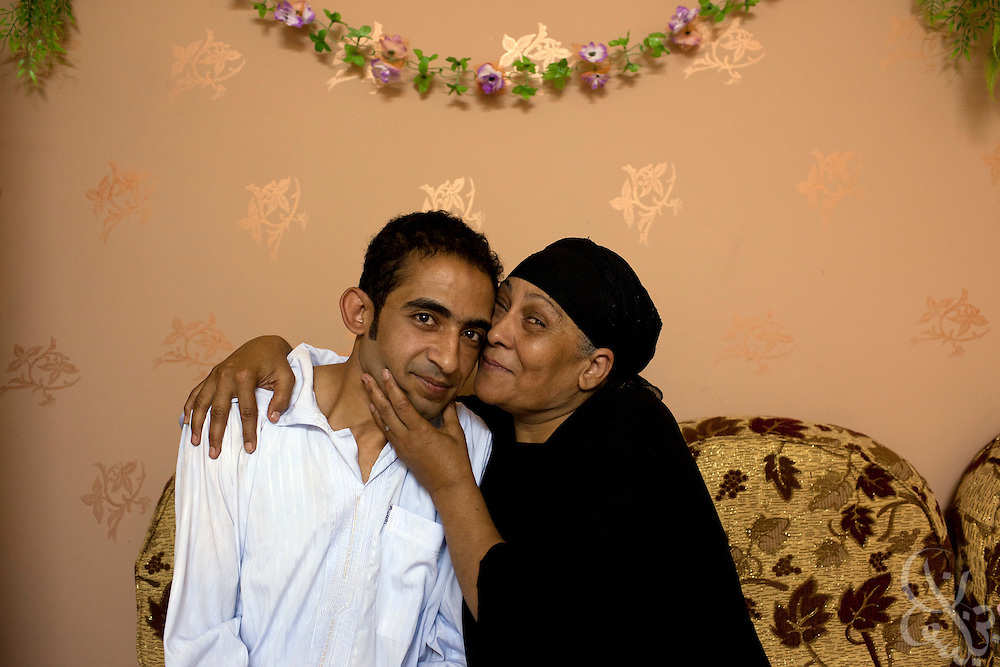 Leila Yusef kisses her son Ahmed in their home in the Nile Delta village of Shalakan, north of Cairo July 16, 2011. Yusef worries for the safety of her children in post revolutionary Egypt, while Ahmed struggles to make a living at the local cola bottling plant. Despite the revolution, promised wage raises have gone unpaid.  (Photo by Scott Nelson)