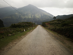 Perspective of a tiny road going through a mountainous landscape. Ha Giang province, Vietnam, Asia