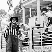 A rodeo clown entertains the crowd as bull riders prepare for the next event.<br />