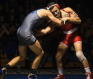 Rancocas Valley's Pedro Hernandez battles Northern Burlington's Vincent Foggia during the wrestling meet at Northern Burlington County Regional High School in Mansfield , N.J., Wednesday, February 4, 2015.  Photo by Bryan Woolston / @woolstonphoto.