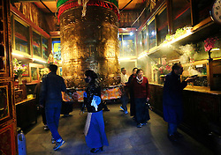 A picture made available on 19 September 2016 of Tibetan pilgrims walk around a Buddhist prayer wheel in the Jokhang Temple in the early morning in Lhasa, Tibet Autonomous Region, China, 09 September 2016. Jokhang Temple is considered one of the most sacred site for Tibetan buddhists built during the rule of King Songtsen Gampo in the 7th century.
