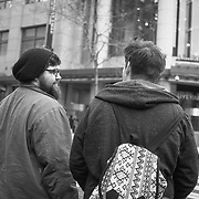 2017 MARCH 05 - Two men on Pine St near Emerald City Comicon, downtown, Seattle, WA, USA. By Richard Walker