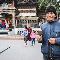 Man outside a Buddhist temple in Bhutan, taken by Rohit Gajmer.