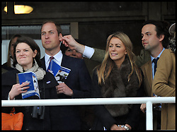Prince William gets his ear pinched as he and the Duchess of Cambridge watch the first race at Cheltenham Racecourse on Gold Cup day, Friday March 15, 2013. Photo By Andrew Parsons / i-Images