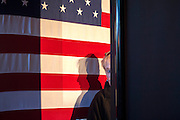 CHARLESTON, SC _ FEBRUARY 10, 2016: A volunteer peaks around a banner as she waits for Gov. John Kasich of Ohio to speak during a campaign stop at Finn's Brick Oven, Wednesday, Feb. 10, 2016 in Mount Pleasant, S.C.  CREDIT: Stephen Morton for The New York Times