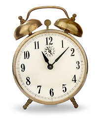 Vintage brass alarm clock with bells on top, isolated on white with clipping path