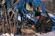Darkhad woman &amp; Ovoo<br /> Lighting incense<br /> Darkhad Depression<br /> Northern Mongolia