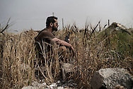 Iraq, Kurdistan: Peshmerga soldier in Sinjar. <br /> For more than one year between 2014 and 2015 Sinjar has been under ISIS control. When in November 2015 Peshmerga forces and Yazidi militias backed by US airstrikes entered the town and fully regained full control from IS, found the city heavily destroyed. Alessio Romenzi