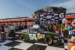 Fontana, CA/USA (Saturday, March 23, 2013) - NASCAR Nationwide Series car driver Kyle Busch celebrates with wife Samantha at victory lane after winning the 2013 Royal Purple 300 at the Auto Club Speedway in Fontana, CA. PHOTO © Eduardo E. Silva/SILVEX.PHOTOSHELTER.COM.