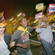 Thais take to the streets during anti-government demonstrations in Bangkok.