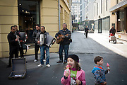 Local buskers play their instruments on one of the main streets in Bienne, Switzerland. Image © Angelos Giotopoulos/Falcon Photo Agency