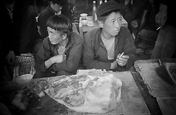Two Vietnamese butcher men at Xa Phin market, Ha Giang Province, Vietnam, Southeast Asia