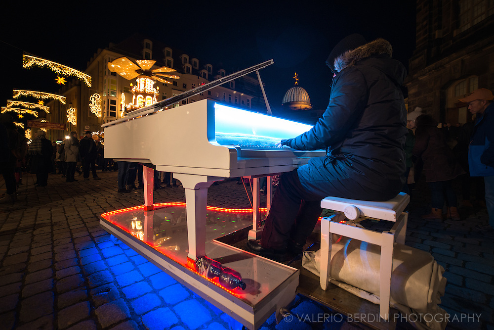 A piano player a night in Neumarkt, central Dresden. Germany