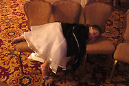 Lydia Hertzier, a dancer from Williamsberg, VA sleeps after performing at the New York Dance Alliance's national competition finale July 10, 2005 in New York City.<br />