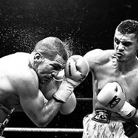 19 November 2009: Fight between Djamel Selini (left) and Tarik Khaidouri (right) during the Grand Tournoi boxing semi finals event at Cirque d'Hiver in Paris, France..