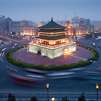 China, Xi'an, Traffic circles around historic Bell Tower at dusk