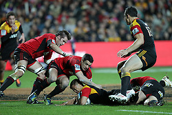 Crusaders' Richie McCaw, left, Dan Carter and Andy Ellis tackle Chiefs' Tim Nanai-Williams supported by Sonny Bill Williamsin a Super Rugby match, Waikato Stadium, Hamilton, New Zealand, Friday, July 06, 2012.  Credit:SNPA / David Rowland