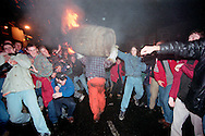 """THROUGH THE CROWD""..THE TAR BARRELS OF OTTERY ST MARY EAST DEVON..BY RUPERT RIVETT © 2003.07771928201.(01273)695107"