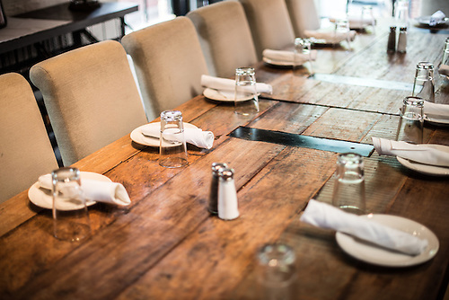 Attractive Simple Table Setting In A Restaurant On A Solid Wooden Table.