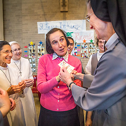 Lisa Johnston | lisajohnston@archstl.org | Twitter: @aeternusphoto<br /> <br /> Gianna Emanuela, daughter of St. Gianna Beretta Molla, visited St. Louis to spread the message of her saint mother's legacy. The visit was sponsored by the Pro-Life Ministray at St. Gianna Parish in Wentzville. Gianna completed her visit to St. Louis with Mass at the Cathedral followed by a talk and reception in Boland Hall. She greeted Sister Elexandria Morrison, FSGM is the Novice Director of the Sisters of St. Francis of the Martyr St. George in Alton.  When she learned in the morning that Gianna Emanuela would be at the Cathedral she quickly gained permission to take her novices and get all their daily chores done so they could meet her.  Gianna Emanuela handed sister a small relic of her saint mother.