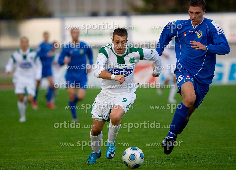Agim Ibraimi of Olimpija vs Jovan Vidovic of Domzale at football match of 15th Round of Slovenian Prva Liga between NK Domzale vs NK Olimpija, on October 28, 2009, in Sports park Domzale, Domzale, Slovenia.   (Photo by Vid Ponikvar / Sportida)