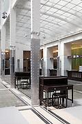 Tapered alumium columns and original furniture. Post Office Savings Bank, Vienna, Austria 1904-12 Architect: Otto Wagner