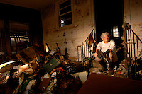 """""""My house is a huge mess because I'm a lover of books and I must have had close to a thousand books in the house and I was able to rescue maybe eight or ten of them."""" ..""""I'd like to move back to the city, but unless they do something about the canal levys, I'm not willing to risk living with the kind of levees that are on the canal now."""" ..Patti Reynold's Lakeview home was destroyed by the floods following the levee break caused by Hurricane Katrina two months prior.  Wednesday, Nov. 2, 2005.  (Robert Caplin/The New York Times).."""