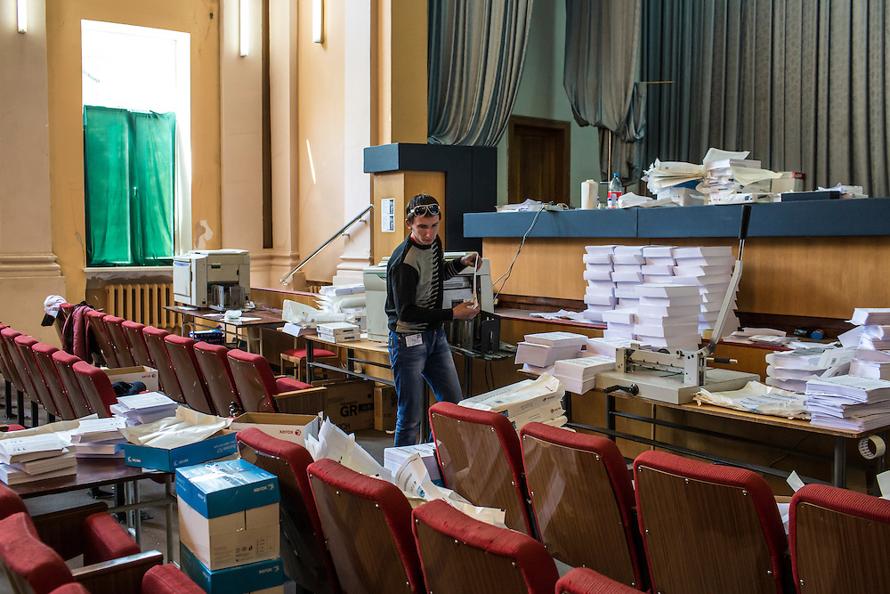 DONETSK, UKRAINE - MAY 7: A man prepares ballots and flyers for a planned referendum seeking greater autonomy from the central government in Kiev, scheduled for May 11, in a building occupied by pro-Russian protesters on May 7, 2014 in Donetsk, Ukraine. Tensions in Eastern Ukraine are high after pro-Russian activists seized control of at least ten cities and ahead of the Victory Day holiday and a planned referendum on greater autonomy for the region. (Photo by Brendan Hoffman/Getty Images) *** Local Caption ***