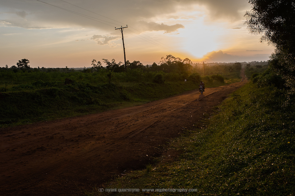 A motorcyclist on a road near Tororo, Uganda at sunset on 1 August 2014.