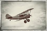 1928 Travel Air biplane takes off