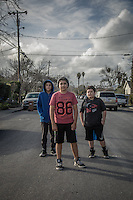Twelve year old friends Jorge Robledo, Jose Vega and Bernardo Cruz stand on Washington Street in Calistoga.