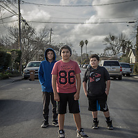 Twelve year old friends Jorge Robledo, Jose Vega and Bernardo Cruz stand on Washington Street in Calistoga.