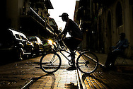man rides a bicyle in the old Panama City known as San Felipe or Casco viejo in Panama City, Panama.