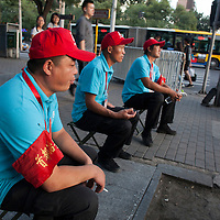 "BEIJING, SEPT.9,2015 : ""volunteers"" show p in the late afternoon of Sept. 2 to make sure the  sidewalks and streets are gradually emptied for the celebrations to  commemorate the 70th anniversary of the end of World War II."