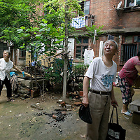 XUZHOU, JULY 22: locals stand in the district where Wendi's family used to live in the early eighties.