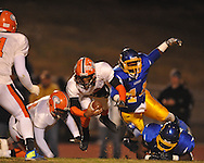 Oxford High's Mike McGhee (10) sacks Jackson Callaway's Chris Mitchell (7) in a MHSAA North 5A playoff game in Oxford, Miss. on Friday, November 29, 2013. Oxford won 23-7 to advance to the Class 5A championship game against Picayune.