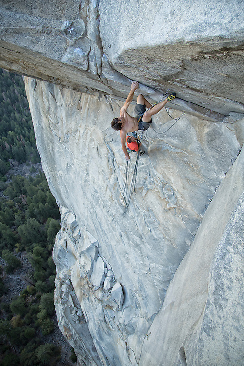 """Belayed by Tommy Caldwell, Alex Honnold makes the second free ascent of the crux roof pitch of """"Wet Lycra Nightmare"""" (13d) on Leaning Tower, Yosemite N.P."""