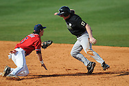 Ole Miss' Blake Newalu (6) tags out Wright State's Jake Hibberd (17) on a steal attempt at Oxford University Stadium in Oxford, Miss. on Sunday, February 20, 2011. Ole Miss won 6-5 to improve to 3-0 on the season.