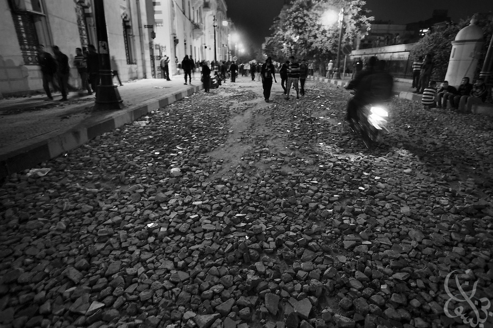 Small rocks lie as evidence of massive street battles on a side street off Tahrir Square following two days of clashes between Egyptian protestors and Egyptian security forces November 20, 2011 in central Cairo, Egypt.  Protestors demanding the transition of power from military to civilian control clashed with Egyptian security forces for a second straight day in central Cairo, with hundreds injured and at least 11 protestors killed.  (Photo by Scott Nelson).