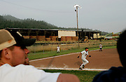 A softball game is held behind the sawmill in Scotia, CA on Tuesday, June 27, 2006. The town of Scotia in Northern California is a company town owned by the Pacific Lumber Company (PALCO), but that will change as the company will begin to sell the town. (Photo by Max Whittaker for The New York Times)<br />