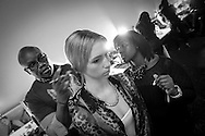 Models and makeup artists prepare backstage for Fashion Week in New York City..Photo by Michael Hickey