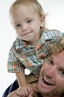 21 July 2008:  One year old toddler Jonah Wells sits ontop of his father Matt (33) shoulders in the studio on white seamless paper silo.