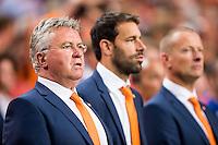 AMSTERDAM - Nederland - USA , Amsterdam ArenA , Voetbal , oefeninterland , 05-06-2015 ,  Bondscoach van het Nederlands elftal Guus Hiddink (l) samen met naast hem assistent Ruud van Nistelrooy (2e r) en keeperstrainer Arno van Zwam (r)